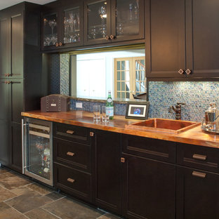 Transitional kitchen remodeling - Example of a transitional kitchen design in Cleveland with copper countertops, black cabinets, blue backsplash, mosaic tile backsplash and recessed-panel cabinets
