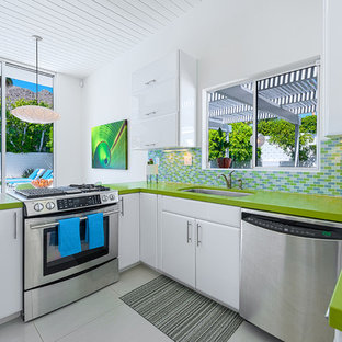 Kitchen - modern kitchen idea in Los Angeles with stainless steel appliances and green countertops