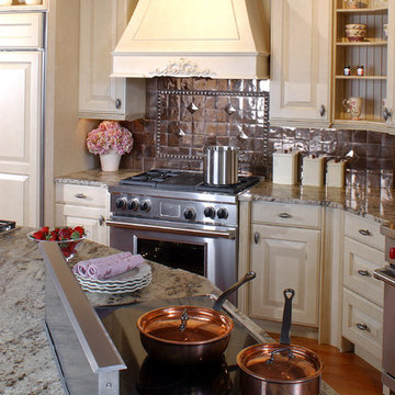 Latte cabinets with a copper backsplash