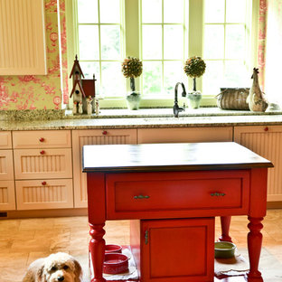 Design ideas for a traditional kitchen in Atlanta with beige cabinets, beaded inset cabinets, granite benchtops, green splashback, stone slab splashback, marble floors, with island and green benchtop.