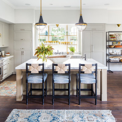 Inspiration for a country l-shaped dark wood floor and brown floor eat-in kitchen remodel in Los Angeles with recessed-panel cabinets, white cabinets, blue backsplash, mosaic tile backsplash, stainless steel appliances, an island and white countertops