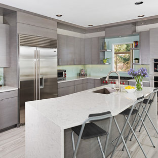 Mid-sized contemporary open concept kitchen designs - Mid-sized trendy l-shaped porcelain floor and gray floor open concept kitchen photo in Other with an undermount sink, flat-panel cabinets, gray cabinets, blue backsplash, glass sheet backsplash, stainless steel appliances, an island and quartz countertops