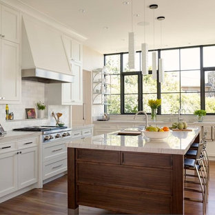 Transitional kitchen remodeling - Kitchen - transitional l-shaped medium tone wood floor kitchen idea in Seattle with an undermount sink, shaker cabinets, white cabinets, white backsplash, stainless steel appliances and an island