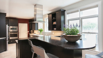 Leathered Granite Peninsula Visually Extends the Kitchen