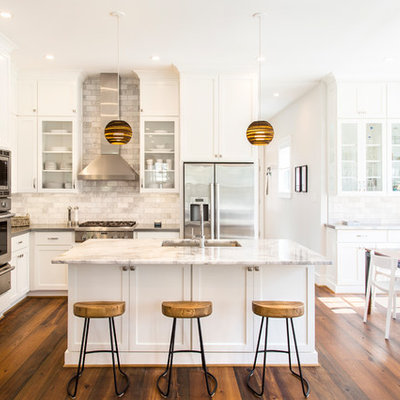 Example of a transitional u-shaped dark wood floor open concept kitchen design in Richmond with an undermount sink, shaker cabinets, white cabinets, gray backsplash, stainless steel appliances and an island