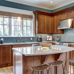 Contemporary open concept kitchen designs - Trendy l-shaped light wood floor open concept kitchen photo in Nashville with concrete countertops, stainless steel appliances, shaker cabinets, medium tone wood cabinets, blue backsplash, mosaic tile backsplash and an island