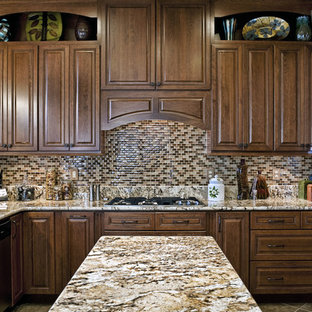 This is an example of a mid-sized traditional u-shaped eat-in kitchen in DC Metro with granite benchtops, raised-panel cabinets, medium wood cabinets, multi-coloured splashback, mosaic tile splashback, an undermount sink, stainless steel appliances, ceramic floors and with island.