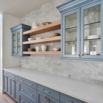 Inspiration for a large country light wood floor and beige floor open concept kitchen remodel in Phoenix with a farmhouse sink, white cabinets, quartz countertops, gray backsplash, marble backsplash, paneled appliances, an island, gray countertops and shaker cabinets