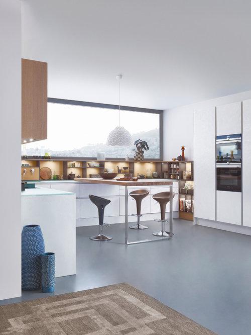 Kitchen design ideas renovations photos with brown for Annmarie ruta elegant interior designs