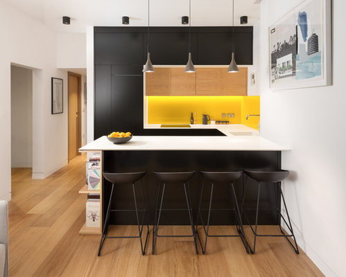 Example Of A Small Trendy U Shaped Light Wood Floor And Brown Kitchen Design