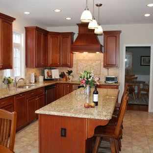Photo of a small traditional l-shaped eat-in kitchen in Charleston with a double-bowl sink, flat-panel cabinets, medium wood cabinets, granite benchtops, yellow splashback, ceramic splashback, stainless steel appliances, ceramic floors and with island.