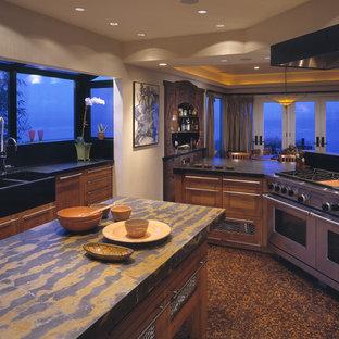 シアトルの中サイズのアジアンスタイルのおしゃれなキッチン (ダブルシンク、インセット扉のキャビネット、淡色木目調キャビネット、御影石カウンター、シルバーの調理設備の) の写真