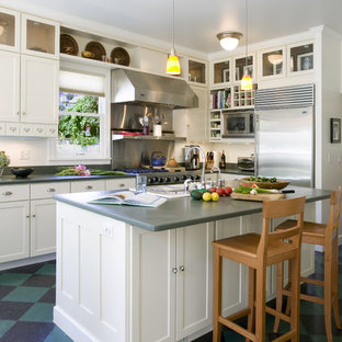 Traditional kitchen pictures - Elegant l-shaped multicolored floor kitchen photo in Seattle with shaker cabinets, white cabinets and stainless steel appliances