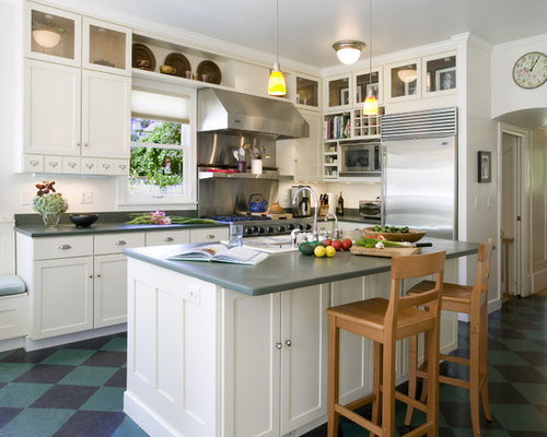 elegant lshaped kitchen photo in seattle with shaker cabinets white cabinets stainless
