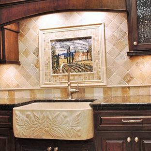 Small mediterranean kitchen ideas - Example of a small tuscan kitchen design in Phoenix with a farmhouse sink, raised-panel cabinets, dark wood cabinets, granite countertops, beige backsplash and ceramic backsplash
