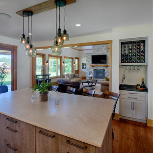 Rustic kitchen photos - Mountain style kitchen photo in Other