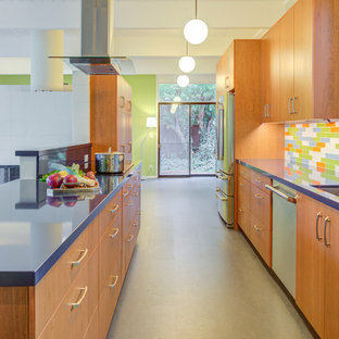 Mid-sized midcentury galley open plan kitchen in San Francisco with an undermount sink, flat-panel cabinets, dark wood cabinets, quartz benchtops, multi-coloured splashback, stainless steel appliances, no island, grey floor, blue benchtop and glass tile splashback.