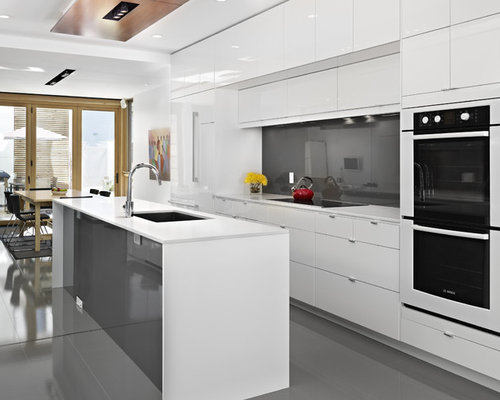 Example Of A Trendy Galley Gray Floor Eat In Kitchen Design In Edmonton  With An