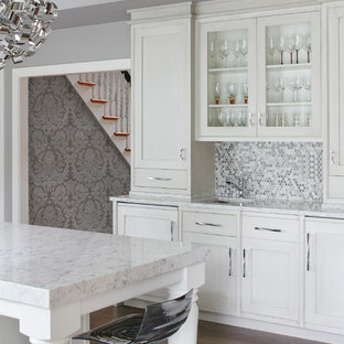Mid-sized transitional eat-in kitchen appliance - Example of a mid-sized transitional eat-in kitchen design in Boston with quartz countertops and an island