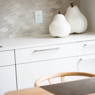 Inspiration for a small contemporary l-shaped eat-in kitchen in Orange County with an undermount sink, flat-panel cabinets, white cabinets, quartz benchtops, grey splashback, marble splashback, stainless steel appliances, porcelain floors, with island, grey floor and yellow benchtop.