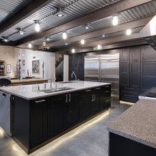 Industrial Kitchen by AVB Inc.