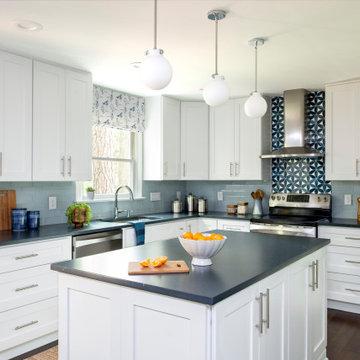 White and blue kitchen with island with white cabinets and soapstone quartz coun