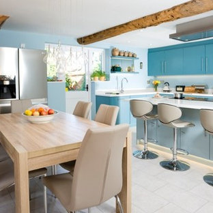 LIGHT AND DARK BLUE KITCHEN WITH BEAMS
