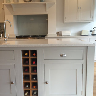 Light grey classic kitchen with beaded cabinets and large island