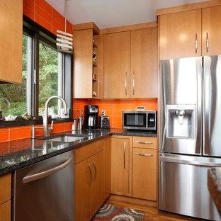 Small contemporary l-shaped separate kitchen in Philadelphia with an undermount sink, flat-panel cabinets, light wood cabinets, quartz benchtops, orange splashback, glass tile splashback, stainless steel appliances, laminate floors, no island, brown floor and blue benchtop.