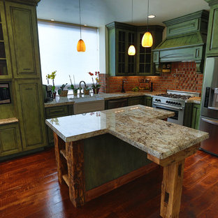 Mid-sized eclectic eat-in kitchen inspiration - Inspiration for a mid-sized eclectic l-shaped medium tone wood floor eat-in kitchen remodel in Portland with a farmhouse sink, raised-panel cabinets, green cabinets, granite countertops, red backsplash, stainless steel appliances and an island