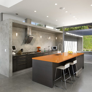 Inspiration for a modern kitchen in Los Angeles with an undermount sink, flat-panel cabinets, brown cabinets and orange benchtop.