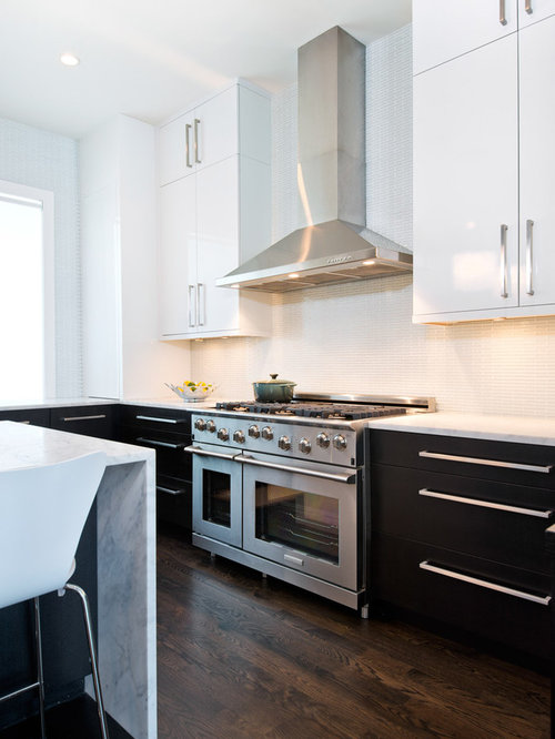 example of a minimalist kitchen design in chicago with marble countertops and stainless steel appliances