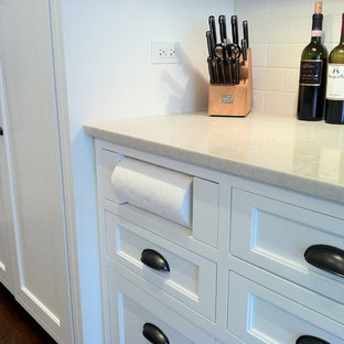 Inspiration for a timeless dark wood floor kitchen remodel in Chicago with recessed-panel cabinets, white cabinets, white backsplash and ceramic backsplash