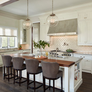 Huge traditional kitchen designs - Huge elegant u-shaped dark wood floor and brown floor kitchen photo in Chicago with an undermount sink, white cabinets, marble countertops, white backsplash, ceramic backsplash, stainless steel appliances, an island and shaker cabinets