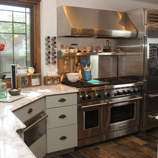Inspiration for a shabby-chic style kitchen in Chicago with a triple-bowl sink, recessed-panel cabinets, green cabinets, quartz benchtops, stainless steel appliances, slate floors and with island.