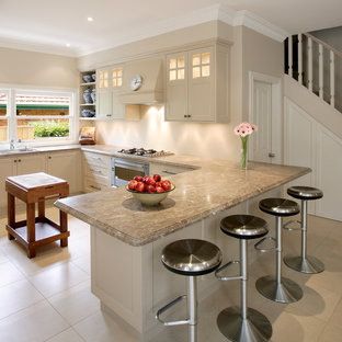 Example Of A Transitional U Shaped Ceramic Floor Kitchen Design In Sydney With Drop