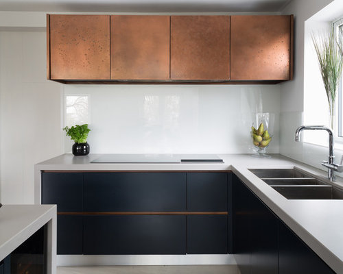 Kitchen with Quartzite Countertops and an Integrated Sink ...