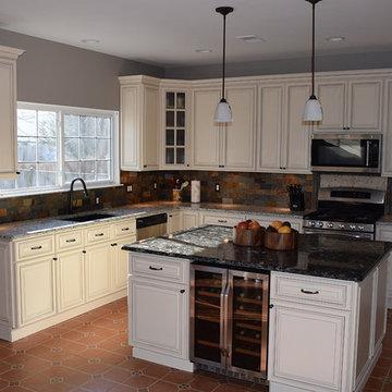 Linen Cabinets with Light Quartz Countertop and Dark Quartz Countertop