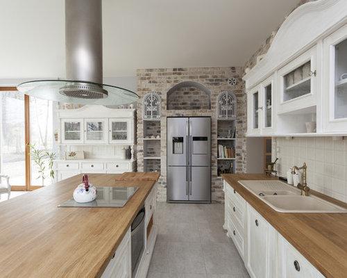 Cucina abitabile shabby chic style con top in legno foto e idee