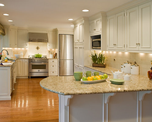 Example Of A Large Classic L Shaped Medium Tone Wood Floor Eat In Kitchen