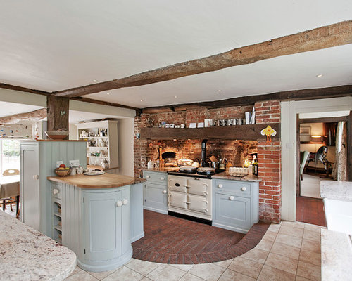 Cucina ad ambiente unico con pavimento in mattoni Londra - Foto e ...