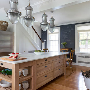 Large transitional kitchen remodeling - Inspiration for a large transitional medium tone wood floor kitchen remodel in Bridgeport with a farmhouse sink, shaker cabinets, medium tone wood cabinets, marble countertops, white backsplash, subway tile backsplash and an island
