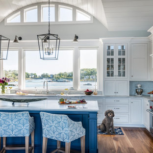 Design ideas for a beach style l-shaped kitchen in Boston with an undermount sink, shaker cabinets, white cabinets, grey splashback, stainless steel appliances, dark hardwood floors, with island, brown floor, grey benchtop and timber.