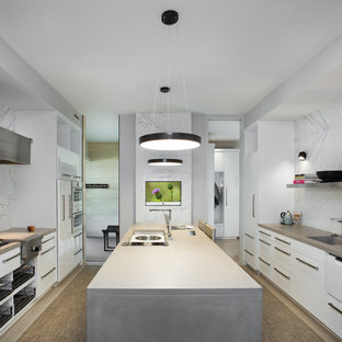 Mid-sized contemporary kitchen appliance - Inspiration for a mid-sized contemporary u-shaped brown floor kitchen remodel in Other with an integrated sink, flat-panel cabinets, white cabinets, concrete countertops, white backsplash, marble backsplash, stainless steel appliances and an island