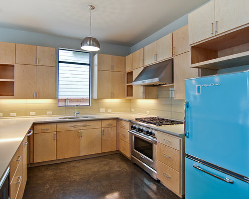 1950s U Shaped Kitchen Idea In Austin With Colored Appliances, Flat Panel  Cabinets