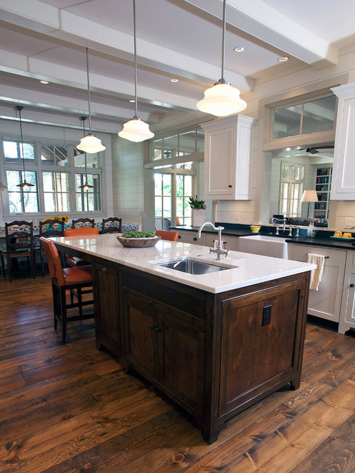 Inspiration For A Timeless Eat In Kitchen Remodel In Austin With A  Farmhouse Sink,