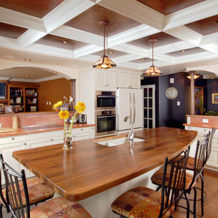 Design ideas for a traditional kitchen in Ottawa with stainless steel appliances, wood benchtops and orange benchtop.