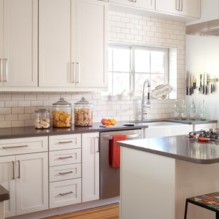 Trendy kitchen photo in Denver with stainless steel appliances and subway tile backsplash