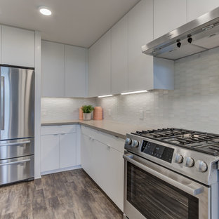 Open concept kitchen pictures - Inspiration for a l-shaped light wood floor open concept kitchen remodel in San Francisco with flat-panel cabinets, white cabinets, white backsplash, stainless steel appliances and an island