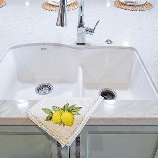 Kitchen - large transitional vinyl floor kitchen idea in Sacramento with an island